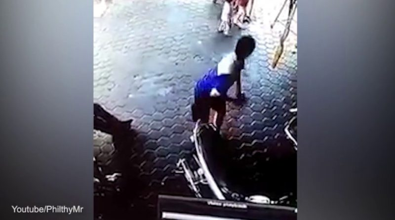 Indonesian-man-saves-his-two-children-from-an-out-of-control-car-with-a-perfectly-timed-BACKFLIP