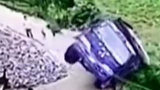 Man-jumps-out-of-truck-window-before-it-falls-off-cliff