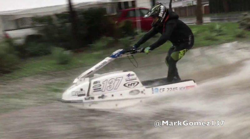 Mark-Gomez-Rides-550-Jetski-Up-Hometown-Flooded-Street-Gutter