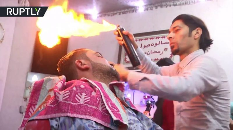 Good-for-blood-circulation-Palestinian-barber-creates-hairdo-using-fire