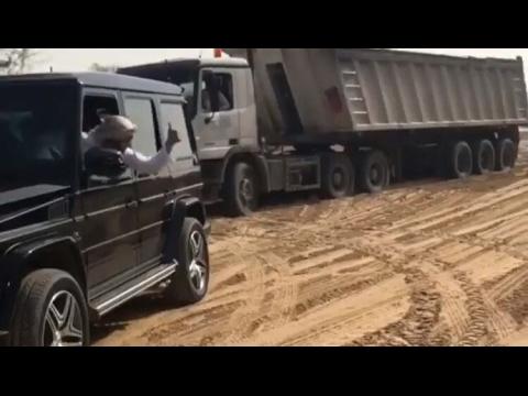 DUBAI-SHEIKH-helps-truck-who-got-stuck-in-Sand