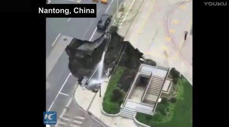 Sinkhole-swallows-minivan-tree-after-heavy-rainfall-in-Nantong-China